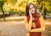 Fall fashion girl pondering. — Stock Photo