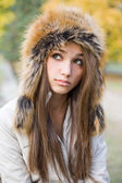Cuteness in fur hat. — Stock Photo