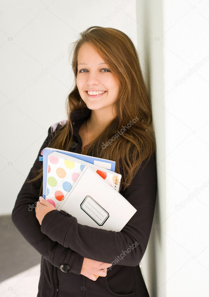 Half length portrait of fresh, cheerful young student girl.  Stock Photo #8327865