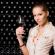 Sensual young brunette with glass of wine. — Stock Photo #8330252