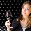 图库照片: Beautiful young womtasting wine.