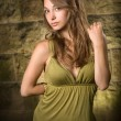Beautiful young brunette posing in green dress. — Stock Photo #8331495
