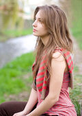 Romantic portraits of young brunette outdoors at spring. — Stock Photo