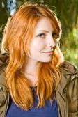 Beautiful young redhead girl outdoors. — Stock Photo