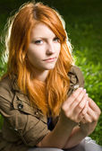 Romantic closeup portrait of a young redhead girl sitting in the — Stock Photo