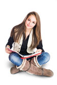 Cute young student girl sitting and reading. — Photo