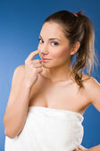 Pretty young woman using body milk. — Stock Photo