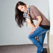 Young brunette jeans model outdoors. — Stock Photo