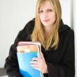 Beautiful young blond student girl. — Stock Photo