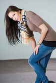 Beautiful young brunette modeling jeans — Stock Photo