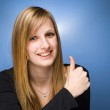 Pretty young blond showing big thumbs up. — Stock Photo