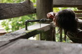 Mangyan Tribe Girl Drinking Water from Faucet — Stock Photo