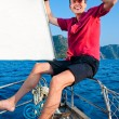 Smiling young man on the yacht — Stock Photo
