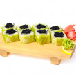 Asian food sushi on wooden plate — Stock Photo