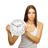 The girl with clock becomes angry — Stock Photo
