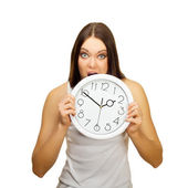 The angry girl bites clock — Stock Photo