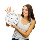 Flickan med klockan i händerna är glad — Stockfoto