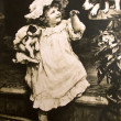 Vintage postcard of a little girl with dogs, circa 1884. — Stock Photo #8610611