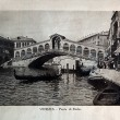 "ITALY - CIRCA 1910: A picture printed in Italy shows image of Venice view Ponte di Rialto with gondola boat, Vintage postcards ""Italy"" series, circa 1910 — Stock Photo"