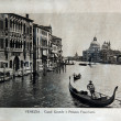"ITALY - CIRCA 1910: A picture printed in Italy shows image of Venice Grand Canal with palazzo Franchetti and gondola boat, Vintage postcards ""Italy"" series, circa 1910 — Stock Photo #9684178"