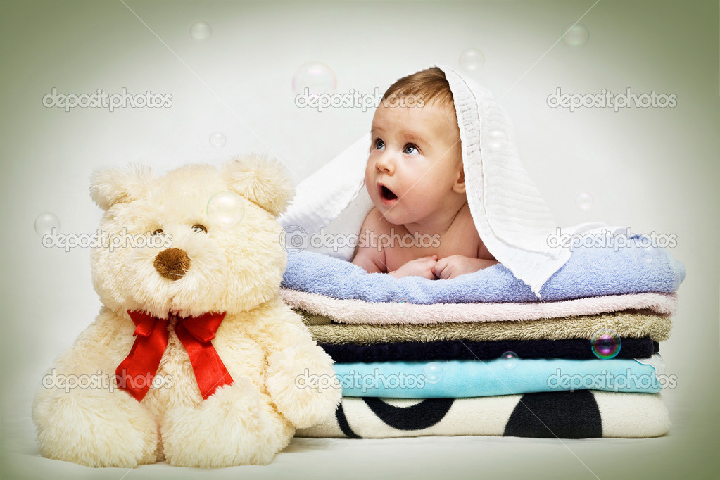 Three-month-old baby lying on towels — Stock Photo #8238555