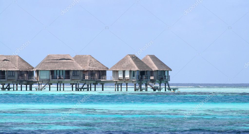 House in the Ocean. island of Paradise. Crystal blue water. Maldives. Luxury holidays. High contrast. — Stock Photo #8214684