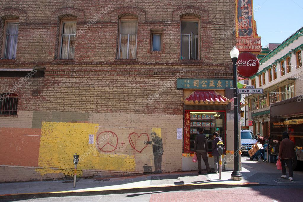 SAN FRANCISCO, CA - CIRCA MAY 2010: Stencil graffiti piece by Banksy on a building in Chinatown, circa May 2010 in San Francisco, CA — Stock Photo #9519363