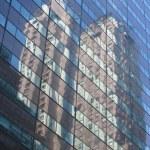 Skyscraper mirrors in another skyscraper — Stock Photo