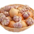 Wicker basket with onion and garlic bulbs — Stock Photo #8759235