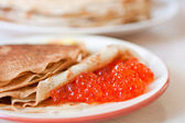 Pancakes with caviar traditionaly served for shrovetide. — Stock Photo