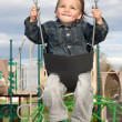 Royalty-Free Stock Photo: Young Boy Swinging