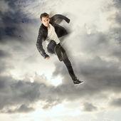 Cool young man jumping and kicking — Stock Photo