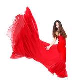 Beyaz zemin üzerine kırmızı akan içinde genç bir kadın elbise — Stok fotoğraf