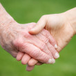 Senior and Young Women Holding Hands — Stock Photo