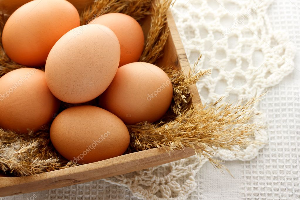 Brown eggs in wooden bowl  Stock Photo #8248147