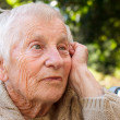 Pensive senior lady — Stock Photo
