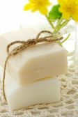 Bar of soap with flowers — Stock Photo