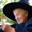 Senior lady in witch costume — Stock Photo