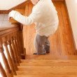 Senior Woman in front of Staircase — Foto Stock