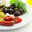 Pickled peppers and olives — Stock Photo