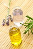 Aroma Oil in Bottles with Herbs — Stock Photo