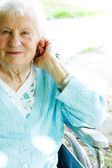 Beautiful senior lady in wheelchair — Stock Photo