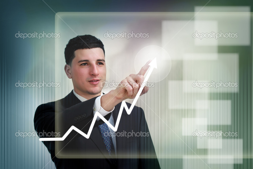 Businessman highlighting business growth on a graph  Stock Photo #8386877