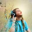 Stock Photo: Young MListening to Music on Headphones