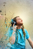 Young Man Listening to Music on Headphones — Stock Photo