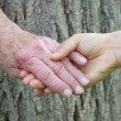 Senior and young woman holding hands — Stock Photo