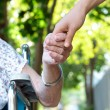 Holding hands with senior lady — Stockfoto #8479466