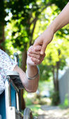 Holding hands with senior lady — Stock Photo