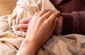 Old and Young Hands on Brown Blanke — Stock Photo
