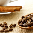 Stock Photo: Coffee beans and cinnamon